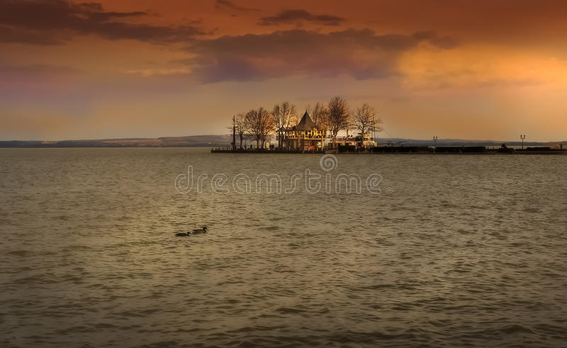 Sunset time over lake in Hungary. Evening at Lake Balaton, Hungary, the largest lake in Europe stock photos