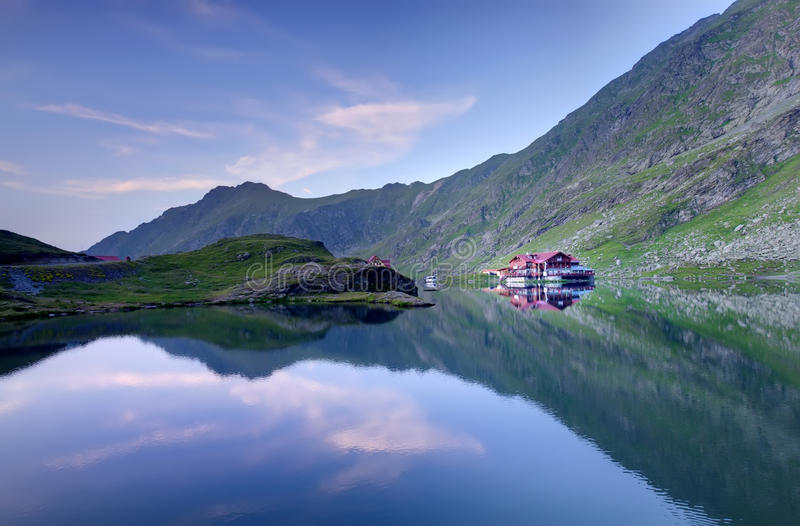 Lake mountain and chalet. Lake Balea Lac in the mountains of Romania royalty free stock image