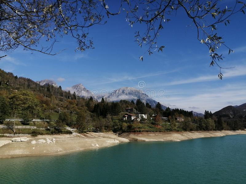 Lake Barcis Italy, Spectacular landscape with background mountains and a green lake green royalty free stock photography