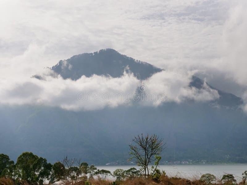 Lake in the volcano crater. Batur, Bali. Lake Batur in the crater of a volcano. Volcano mount and lake Batur located in Kintamani area in Bali, Indonesia royalty free stock images