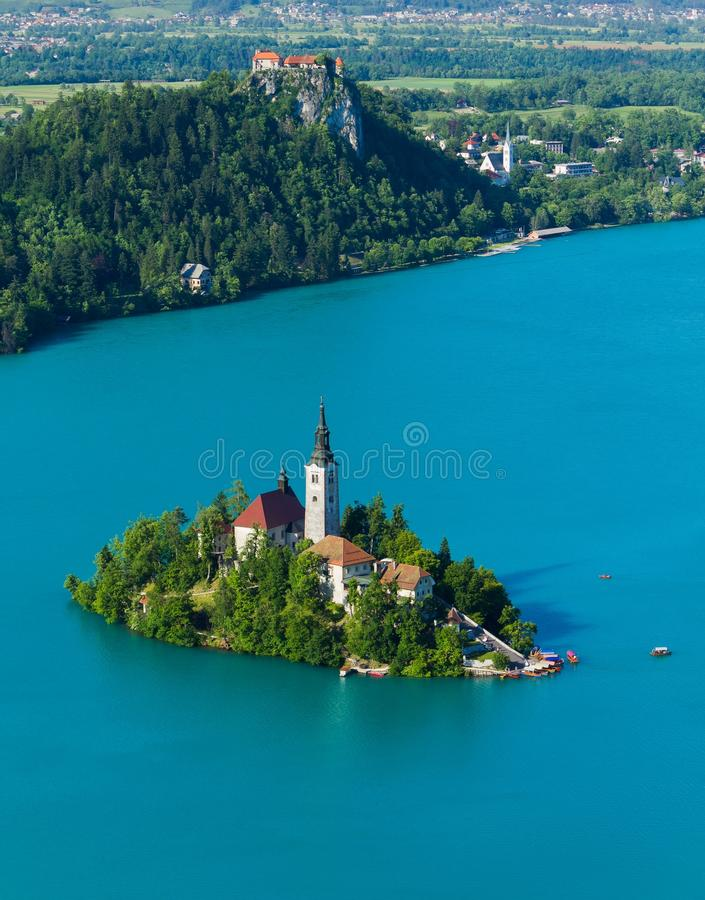 Lake Bled. The beautiful Scenery; island with catholic church in the middle of the lake Bled surrounded by Alps mountains and the castle on the hill in Slovenia royalty free stock image