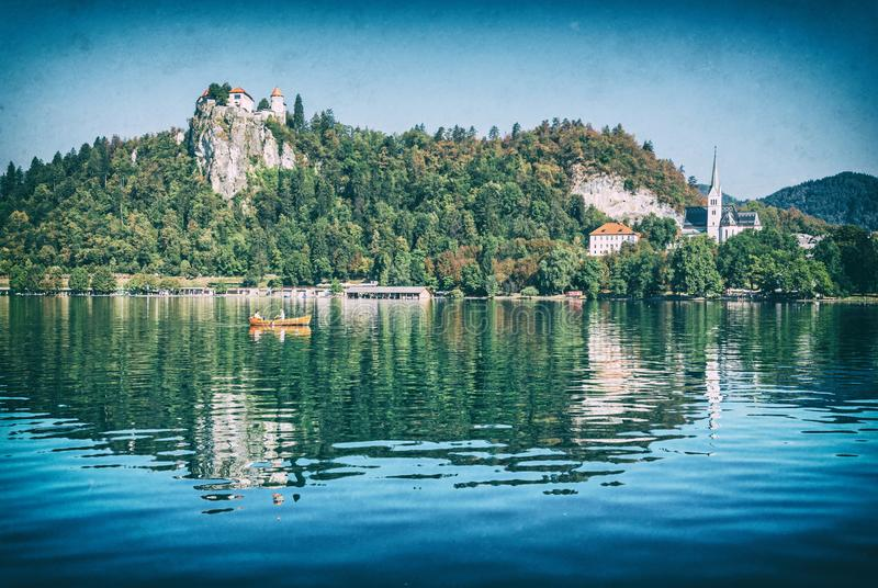 Lake Bled with castle and Assumption of Mary Pilgrimage Church. Lake Bled with castle and St. Martin`s Parish Church, Slovenia, Europe. Travel destination royalty free stock photo