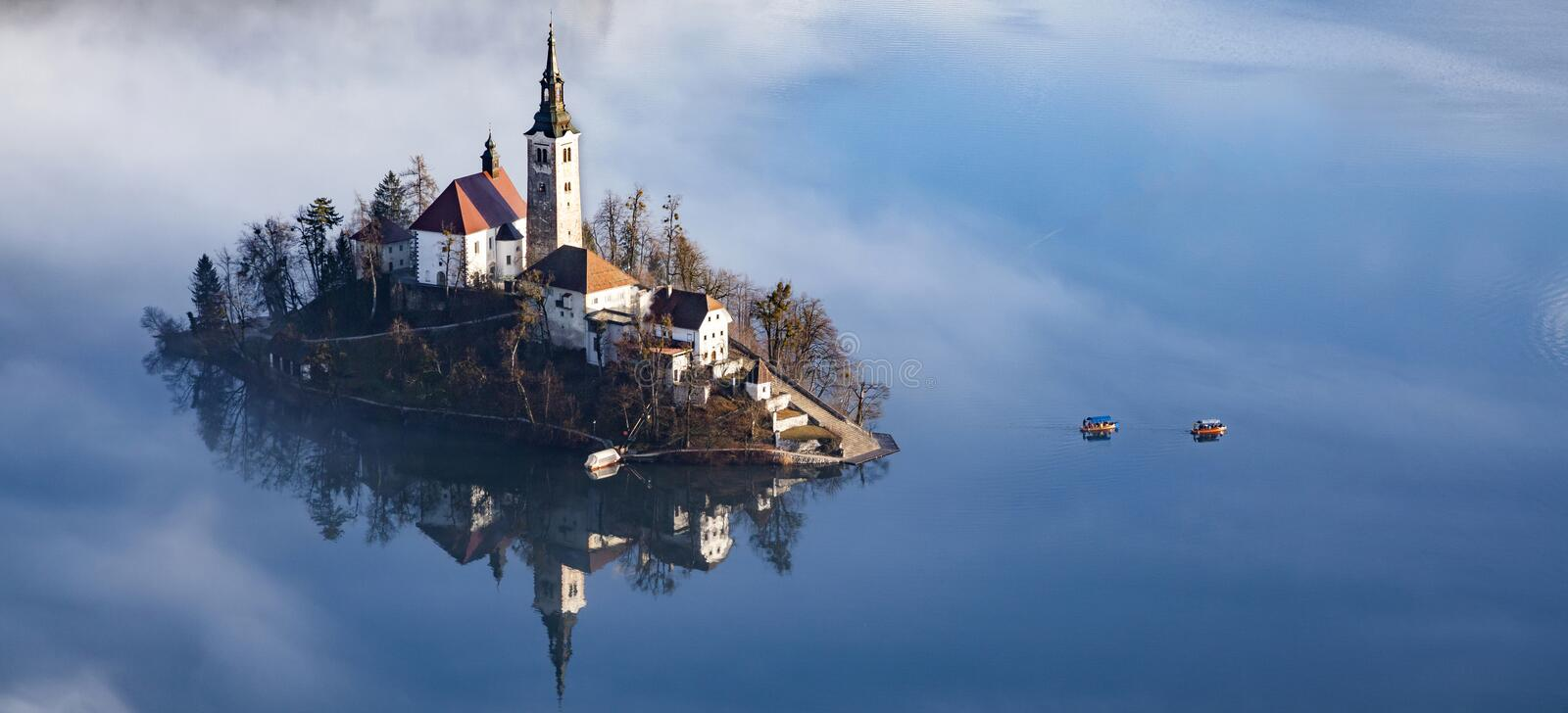Lake Bled in early morning with fog, Slovenia travel. Alpine, alps, amazing, architecture, autumn, background, beautiful, blue, calm, castle, church, cloud royalty free stock photos