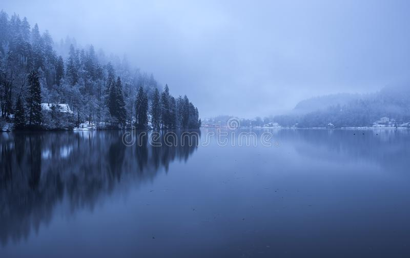 Lake Bled on a foggy and cloudy day royalty free stock photos