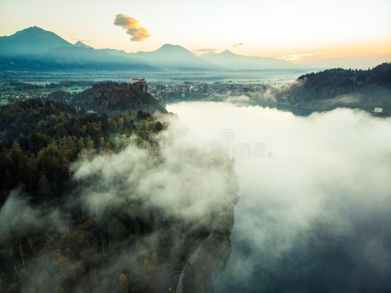 Lake Bled in magic clouds or fog at sunrise,Slovenia royalty free stock images