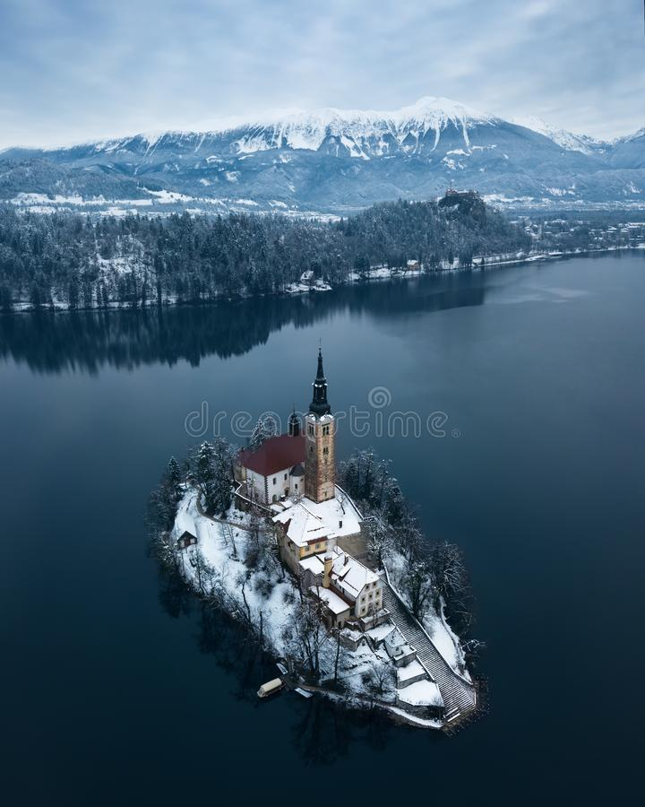 Lake Bled Slovenia. Aerial shot of lake Bled on a calm winter morning with snow royalty free stock photo