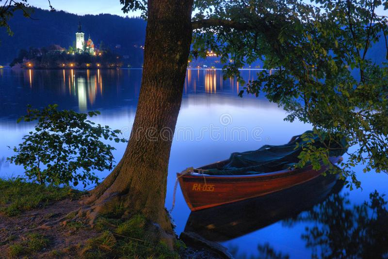 Lake Bled with St. Marys Church of Assumption on small island at night. Bled Slovenia Europe. Mountains and valley on background stock photo