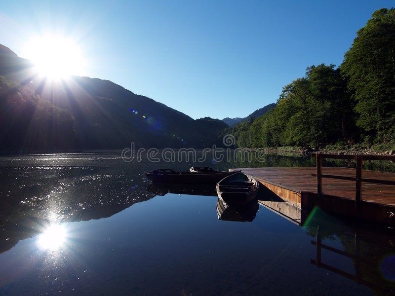 Lake with a boat. And wood stock photos