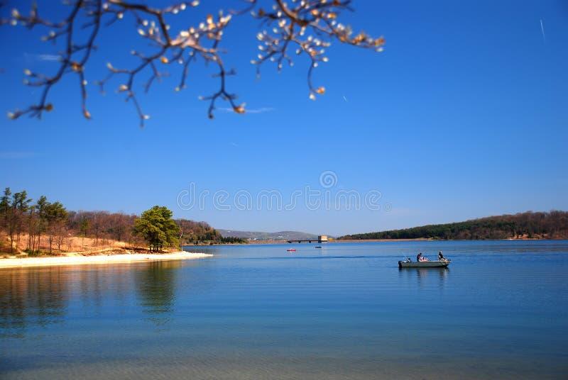 Lake boat. Lake, blue sky and boat royalty free stock photos