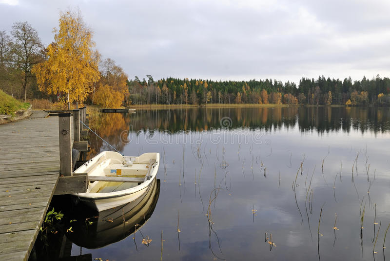 Lake boat harbour in autumn's colors royalty free stock image