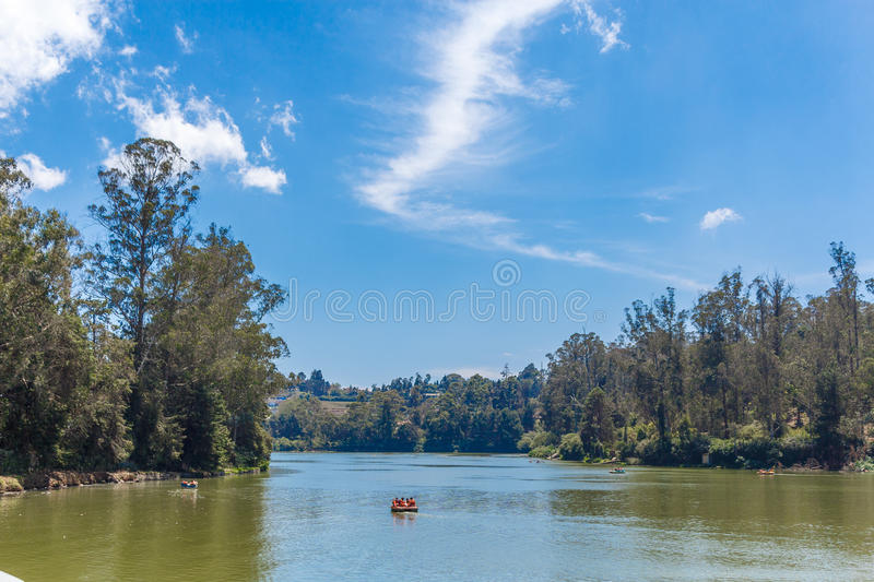 Lake with boats, beautiful tress in the background, Ooty, India, 19 Aug 2016. Lake with boats, beautiful tress in the background stock image