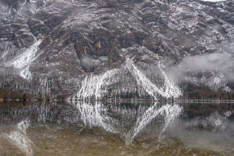 Lake Bohinj with mountains in background stock photos