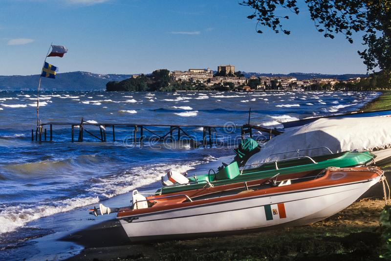 Bolsena, Lazio - Italy. Lake of Bolsena Italy - The medieval town with castle on Lake Bolsena, region Latium, central Italy. On background the medieval village stock photos
