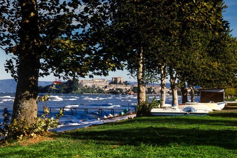 Bolsena, Lazio - Italy. Lake of Bolsena Italy - The medieval town with castle on Lake Bolsena, region Latium, central Italy. On background the medieval village stock image