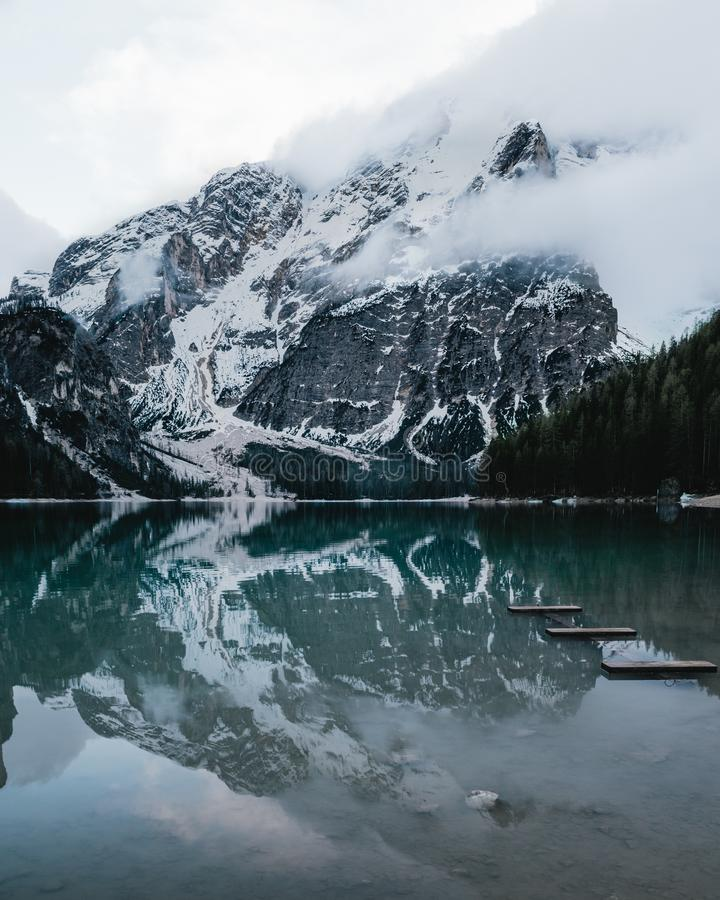 Lake braies and mountains covered with snow stock images