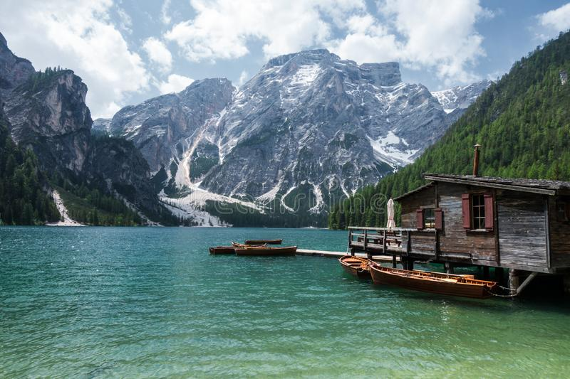 Lake Braies with vivid colors in spring with mountains in the background in the north of Italy stock photo