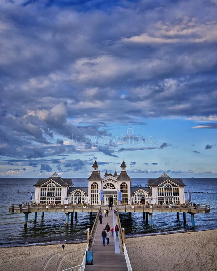 The lake bridge of Sellin on Rügen Island, Mecklenburg-Vorpommern ,Mecklenburg Coast, Baltic Sea, Germany. Pier, beach, spa, tree, water, house, summer stock photography