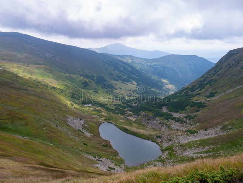 Lake in the Carpathians in the summer sunny day royalty free stock image