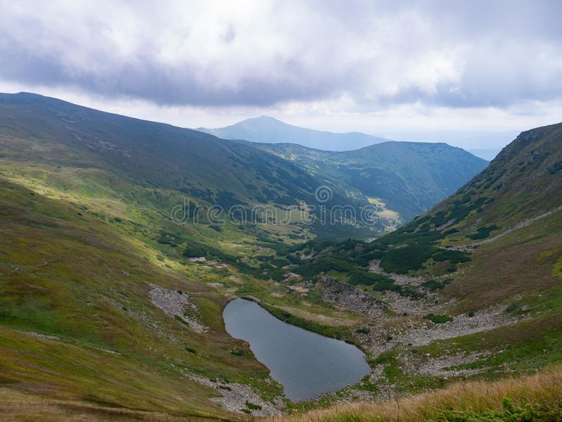 Lake in the Carpathians in the summer sunny day royalty free stock photography