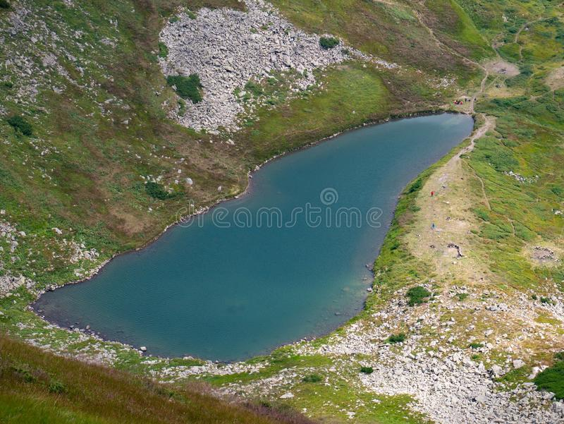 Lake in the Carpathians in the summer sunny day stock photos