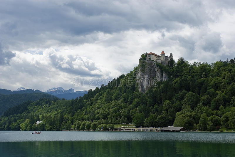 Lake with Castle on Cliff stock photography