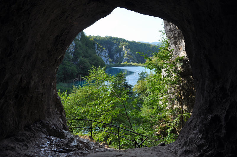 Lake from a cave in Plitvice, Croatia. Beautiful turquoise lake in Plitvice National Park, view from a cave, Croatia stock image