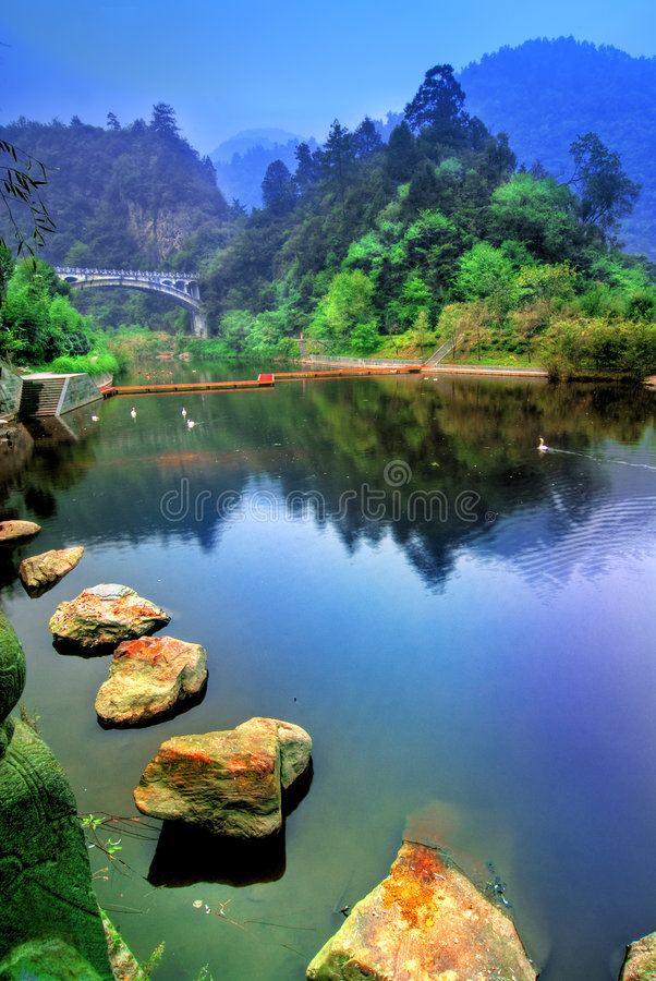 Download Lake in China stock photo. Image of ripples, rocks, forest - 4363704