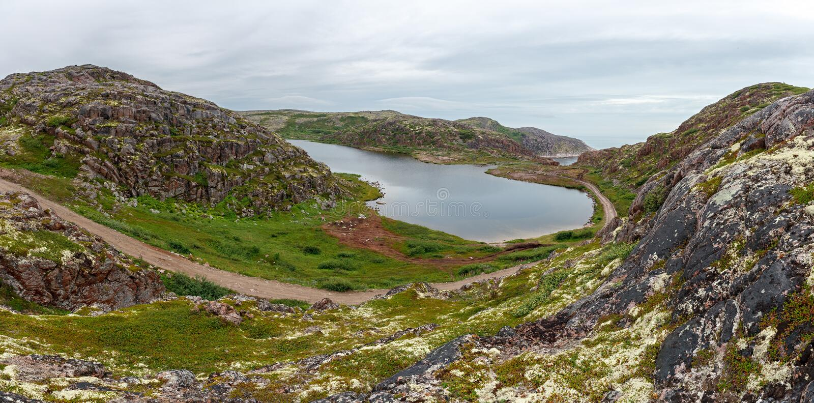 Lake with clean, fresh water on the shore of the Barents sea. stock photo