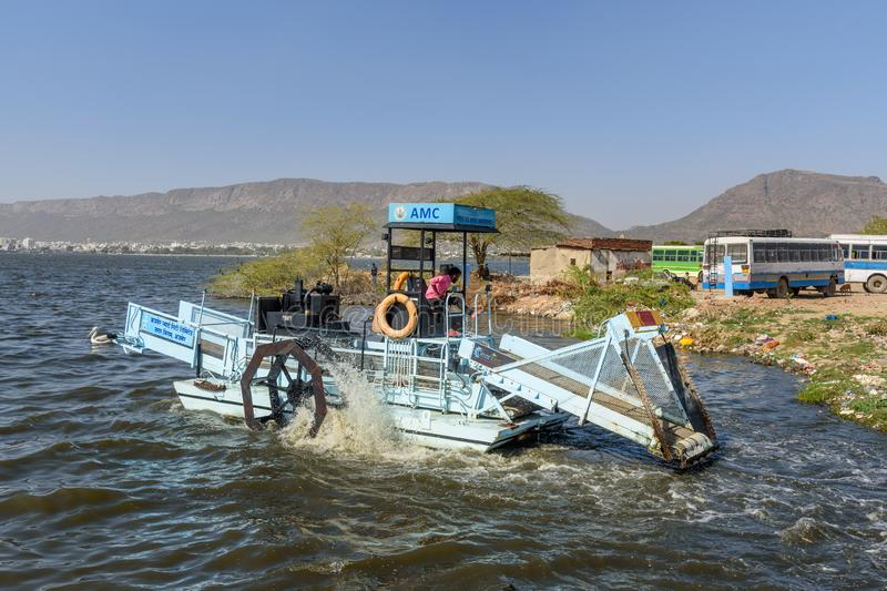 Lake cleaning machine on Lake Anasagar in Ajmer. India. Ajmer, India - February 07, 2019: Lake cleaning machine on Lake Anasagar in Ajmer. Rajasthan stock images