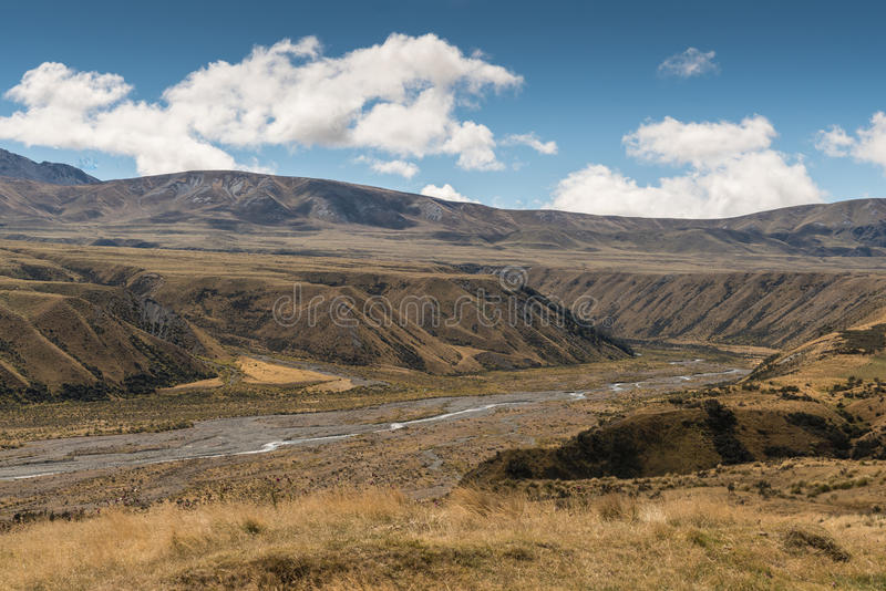 Lake Clearwater drain to Rangitata River, New Zealand. Middle Earth, New Zealand - March 14, 2017: High desert landscape with Lake Clearwater overflow drain to stock photos