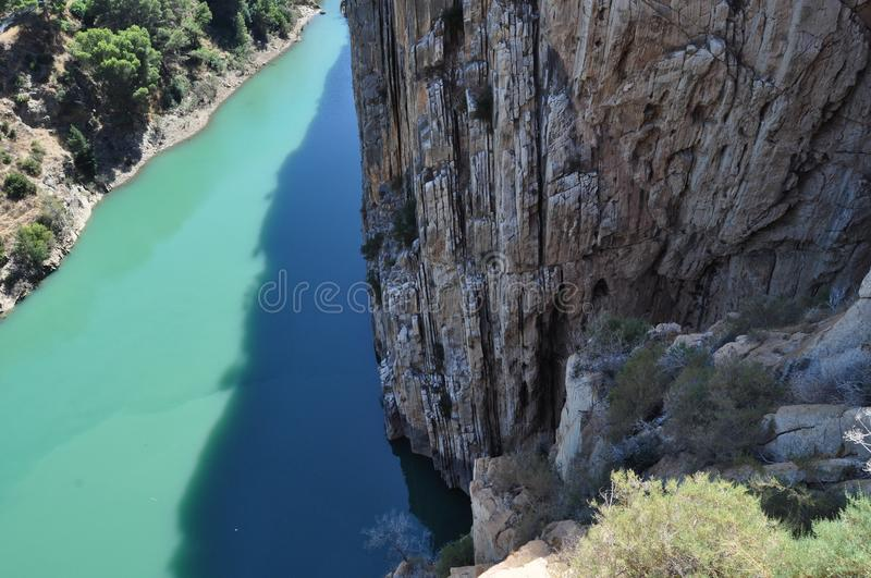Lake and cliff. Imminent danger stock images