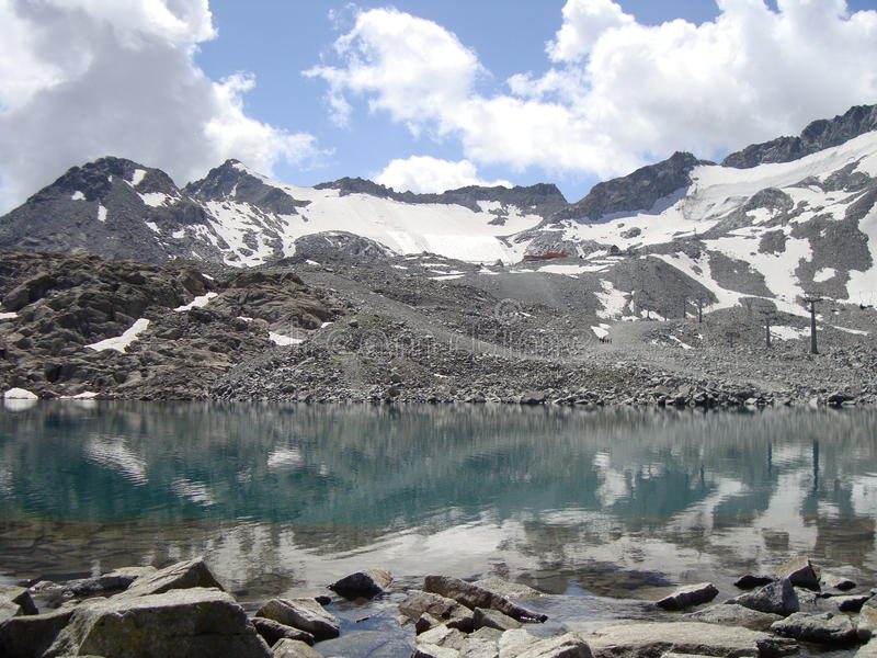 Lake they climb on. With tops mountain reflected in the water royalty free stock photography