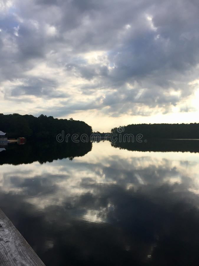 Lake with cloud cover stock photography
