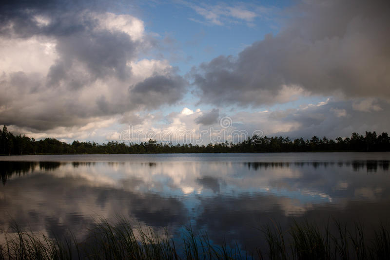Lake, clouds and reflection royalty free stock photography