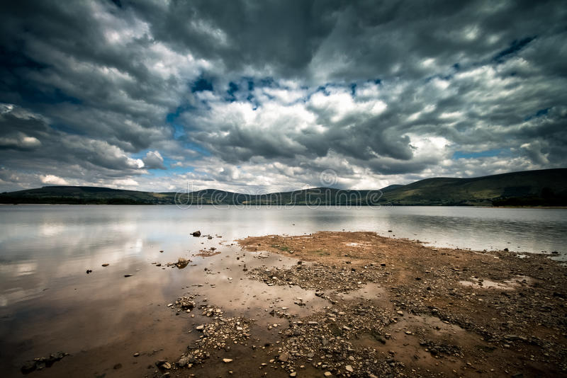 Lake on a cloudy day. Photo of the lake at Blessington, Ireland. Strong contrast on sky and nice lighting on foreground royalty free stock photos