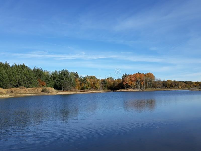 Lake with colourful trees on autumn day stock photo