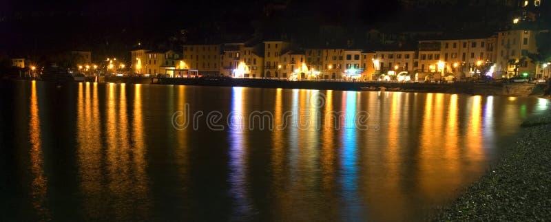 Lake Como. City of Domaso; lights reflect in Lake Como, Italy royalty free stock image