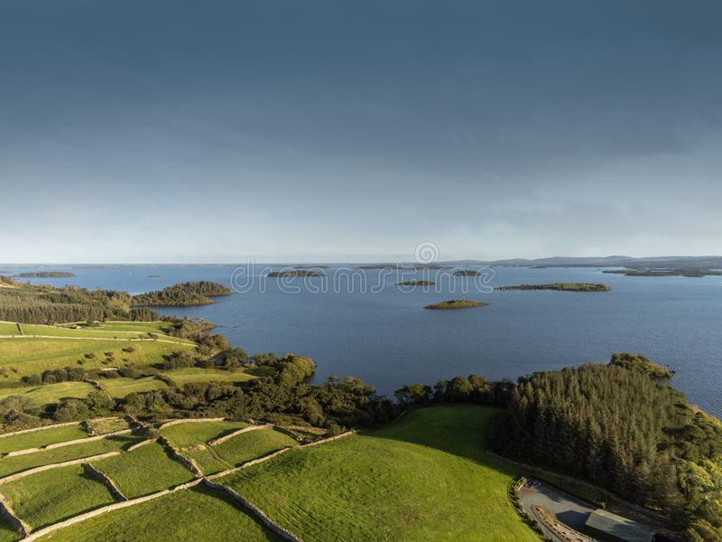 Lake Corrib, county Galway Ireland, Sunny day with clean blue sky and green fields separated by stone fences, islands in the lake royalty free stock photos