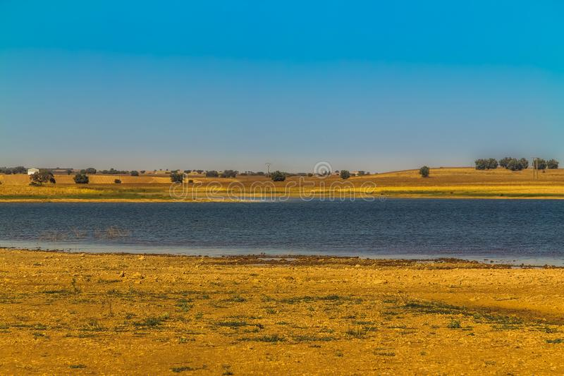 Lake in the countryside. Blue lake in the countryside in the south of Portugal stock photo