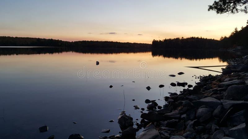 Lake at dawn royalty free stock photos