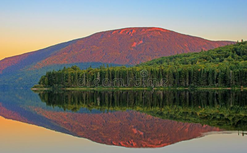 Lake Day Reflection Of Mount Sagamook On Big Nictou Lake. Looking across Big Nictau Lake at Mount Sagamook in Mount Carleton Provincial Park. The location is in royalty free stock photos