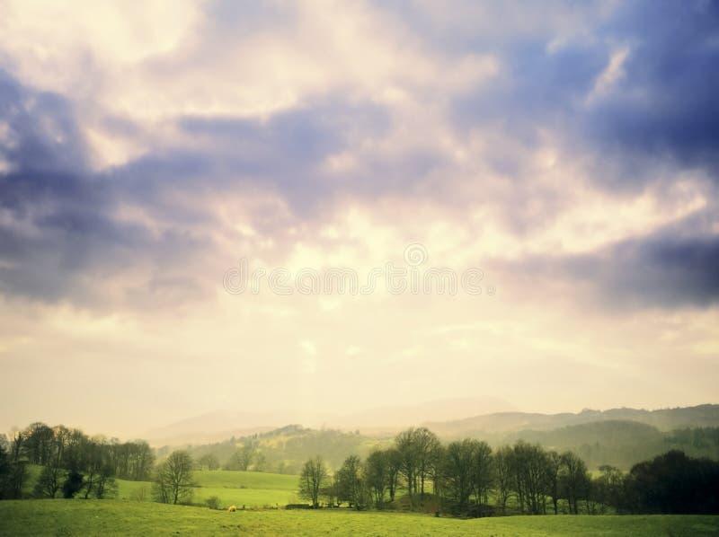 Lake district. National park cumbria england uk - cloudburst and sunburst, sunset over far sawrey royalty free stock images