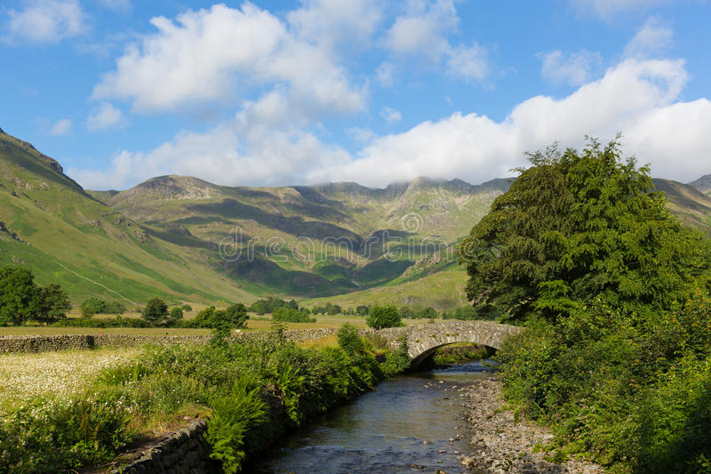Lake District country scene mountains and river summer day Langdale Valley Mickleden Beck river Cumbria England. Beautiful Lake District river Mickleden Beck royalty free stock images