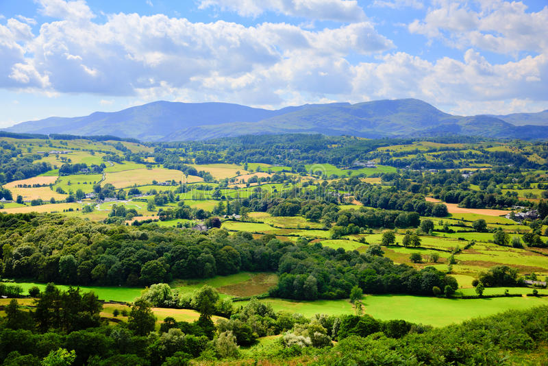 Lake District countryside and mountains view near Hawkshead village England uk. Lake District countryside view Hawkshead England uk on a beautiful summer day stock image