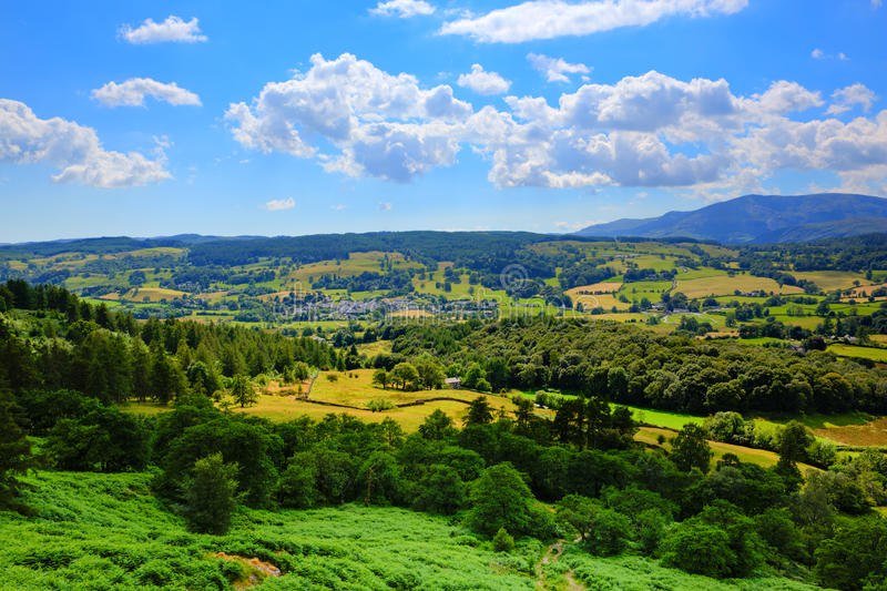 Lake District countryside view to Hawkshead village England uk. Lake District countryside view Hawkshead England uk on a beautiful summer day near this popular stock image