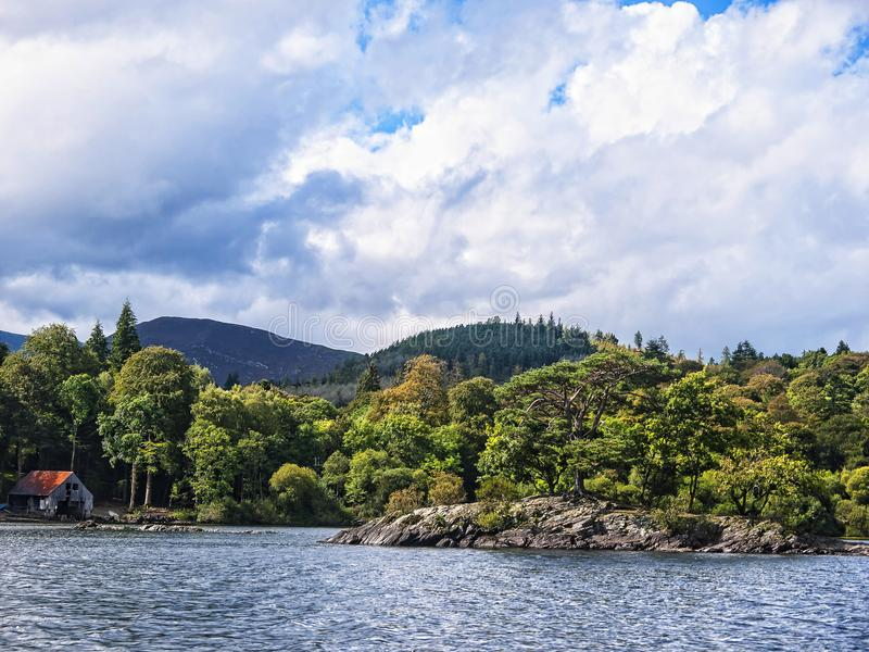 House on Derwentwater in the Lake District in North West England. The Lake District is a place of considerable scenic beauty. It is surrounded by hills known royalty free stock photos