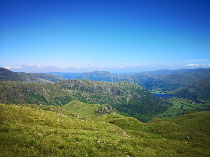 Lake District views. Sun, mountain, hills, green, sku, sky royalty free stock photography
