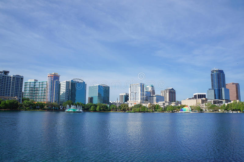 Lake Eola, High-rise buildings, skyline, and fountain Downtown Orlando, Florida, United States, April 27, 2017. High-rise buildings, skyline and fountain at stock photo