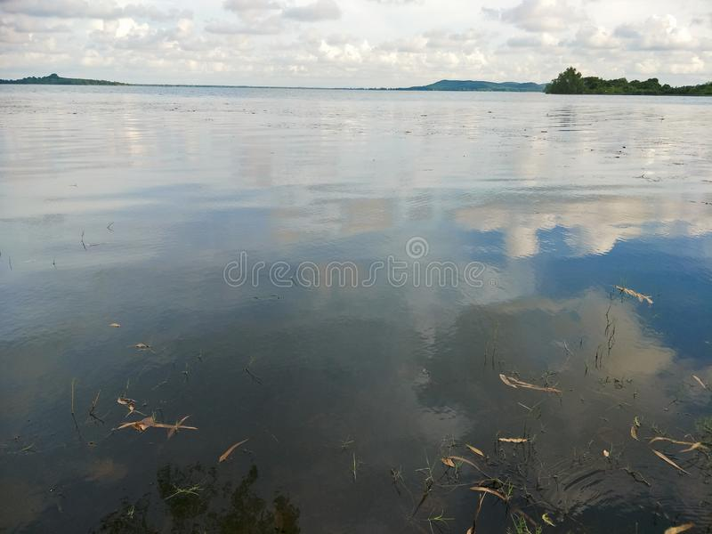 Lake in the evening. A lake is an area filled with water, localized in a basin, that is surrounded by land, apart from any river or other outlet that serves to stock photography