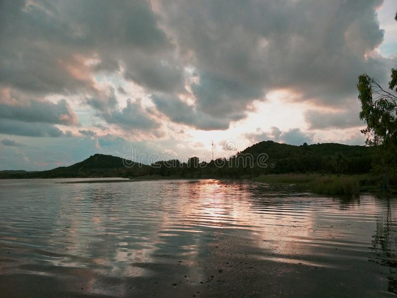 Lake in the evening. A lake is an area filled with water, localized in a basin, that is surrounded by land, apart from any river or other outlet that serves to royalty free stock image